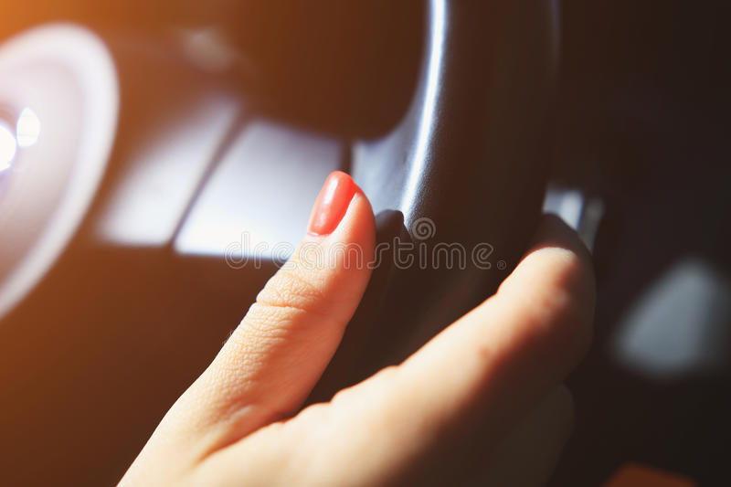 Woman hand on steering wheel royalty free stock images
