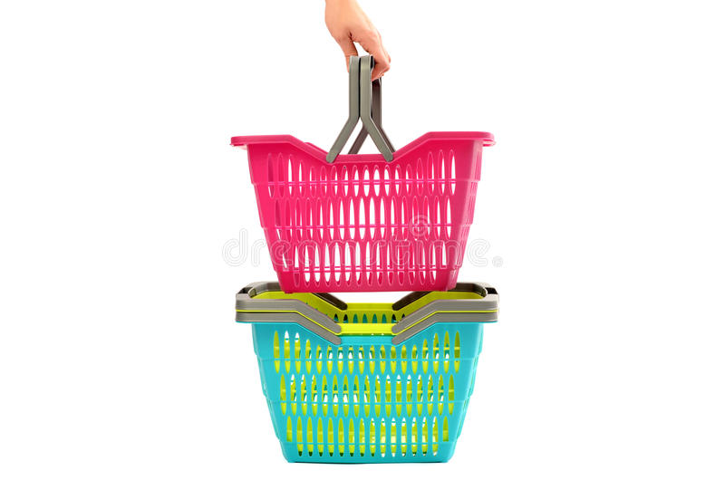 Woman hand taking a shopping basket from a pile. stock photos