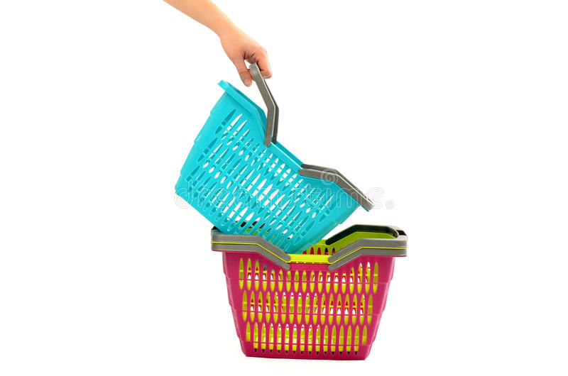 Woman hand taking a shopping basket from a pile. royalty free stock image