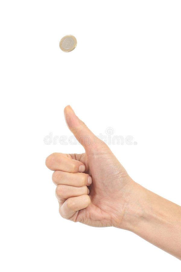 Woman hand tossing a coin royalty free stock photos