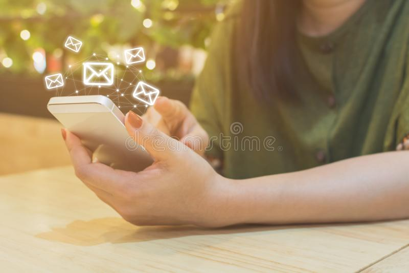 Woman hand using mobile phone with e-mail application, Concept email marketing and newsletter royalty free stock photo