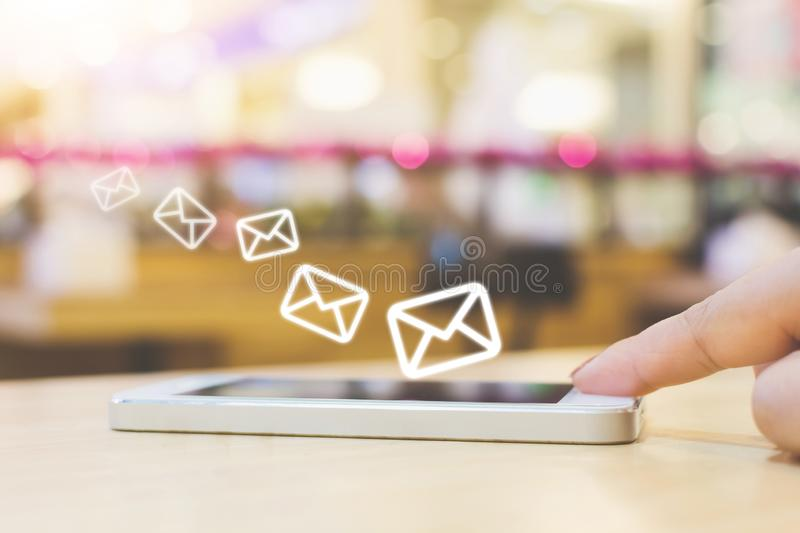 Woman hand using mobile phone with e-mail application, Concept e royalty free stock image