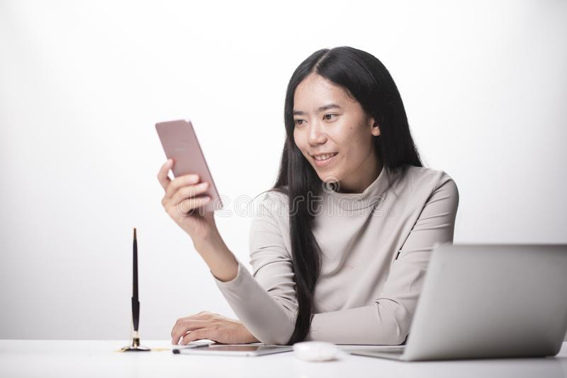 woman hand using smart phone,mobile payments online shopping,omni docking keyboard computer stock photography