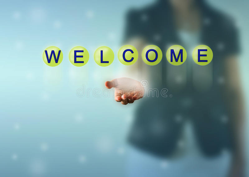 Woman hand and WELCOME words stock photo