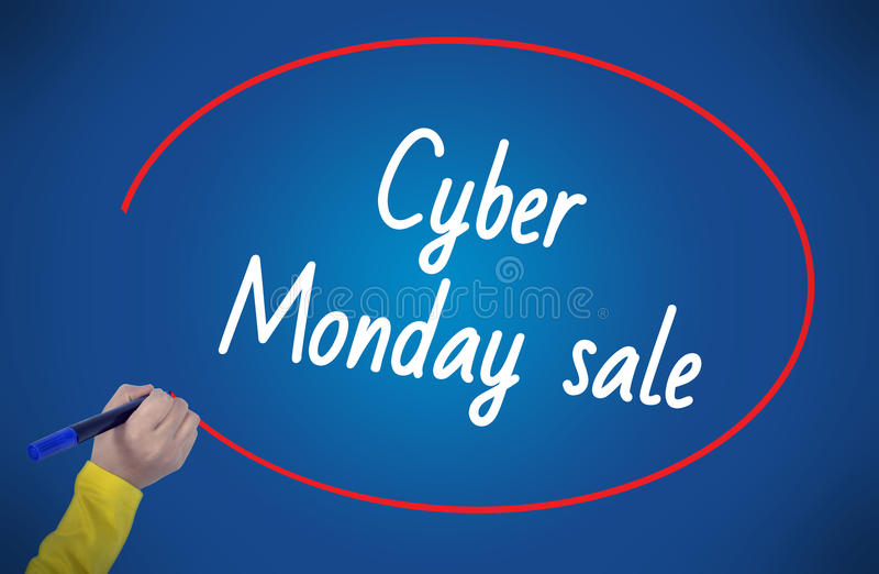 Woman hand writing cyber monday sale with marker. On blue backgorund professionally royalty free stock photos