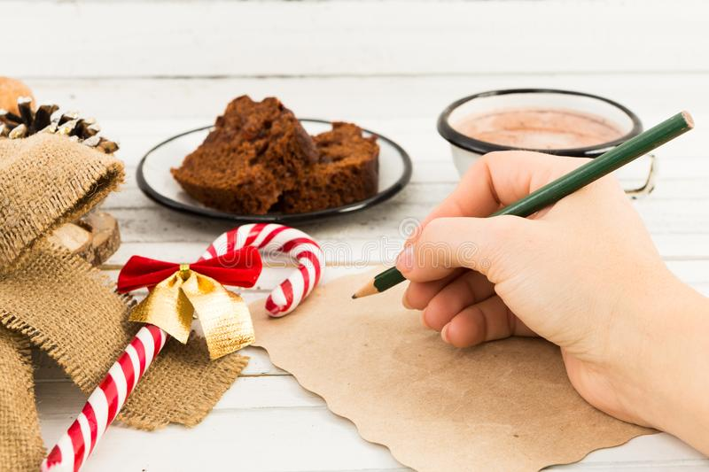 Woman hand writing a letter to Santa Claus royalty free stock photo