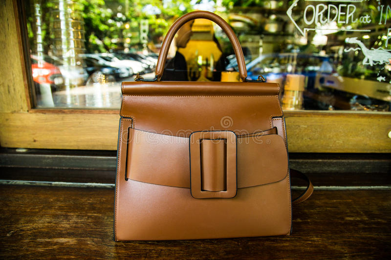 Woman handbag. At the cafe , Female Fashion Concept stock photo