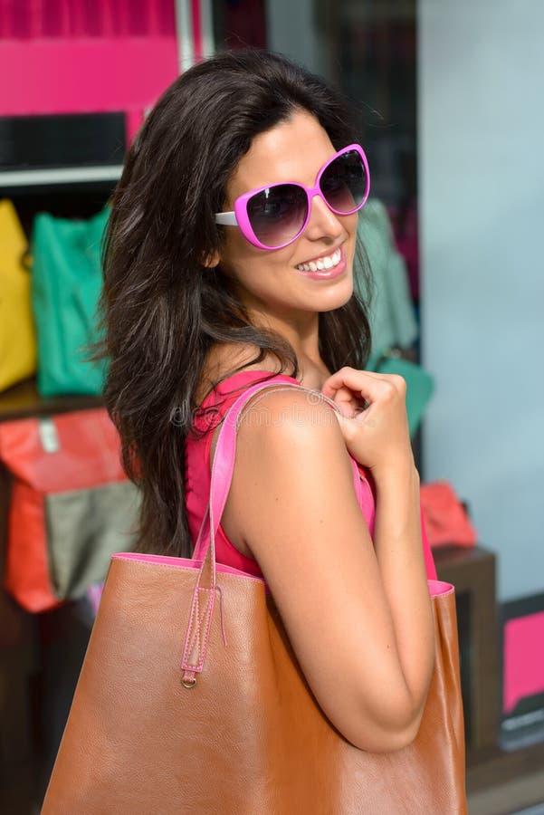 Woman with handbag shopping stock images