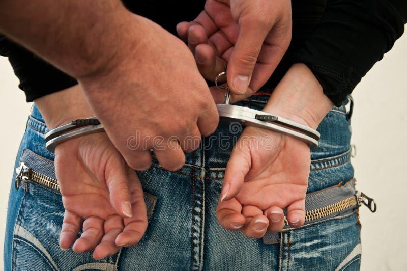 Woman handcuffed royalty free stock image