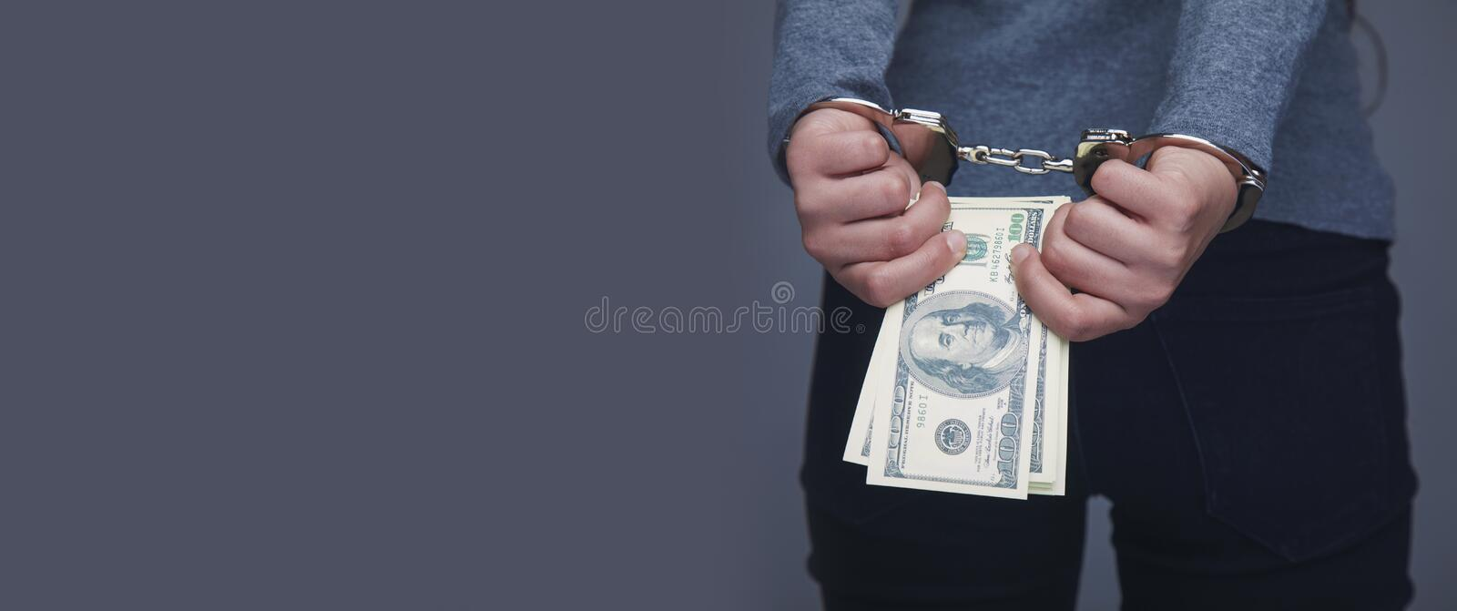 Woman handcuffed for her crimes. Corruption, bribe, justice con royalty free stock image