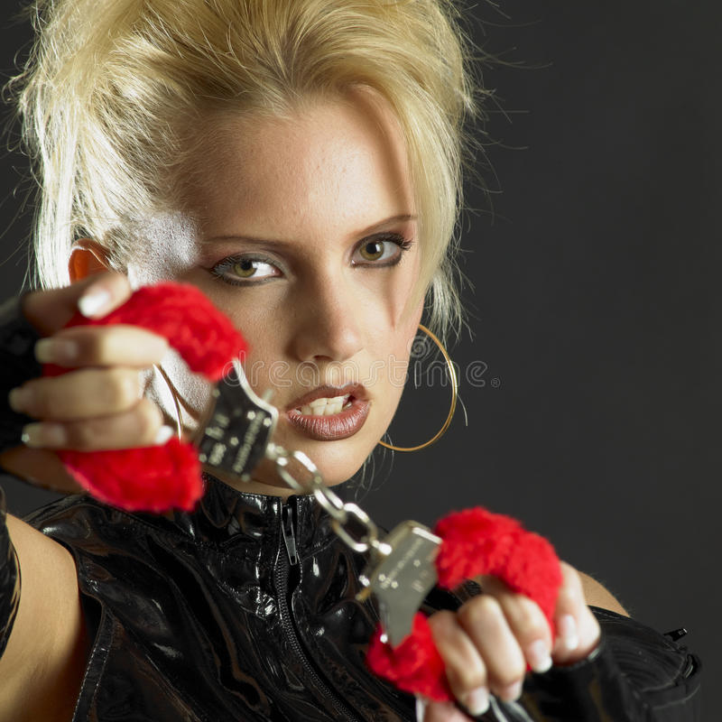 Woman with handcuffs stock photo