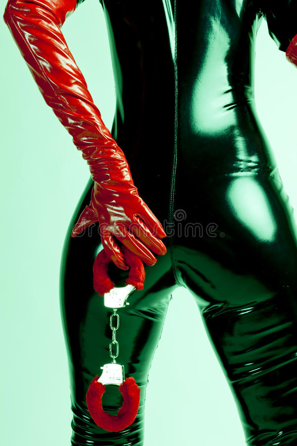 Woman with handcuffs. Detail of standing woman with handcuffs royalty free stock images