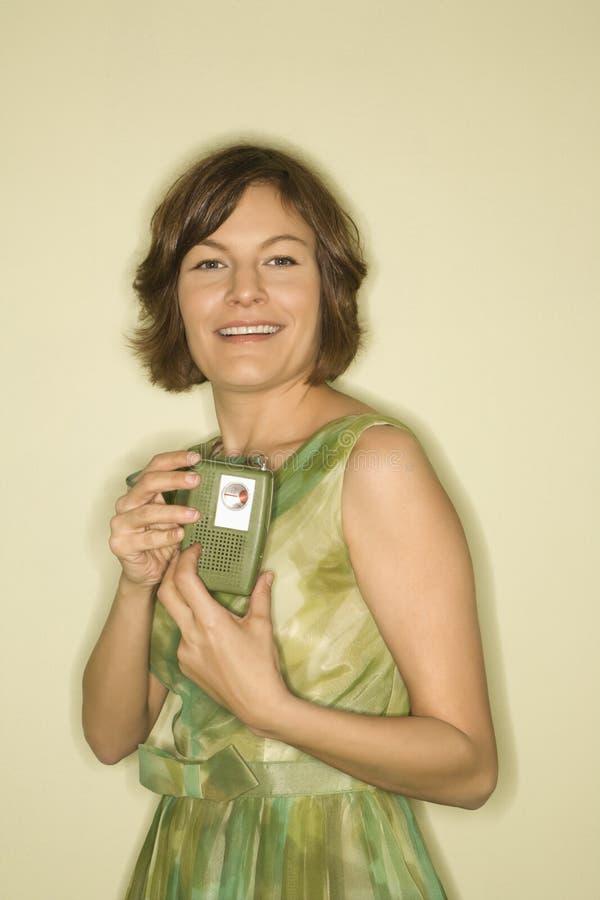 Download Woman With Handheld Radio. Stock Photos - Image: 2425503