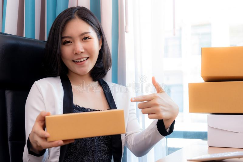 Woman handing package box from online shopping. Woman is handing package box from online shopping stock photos