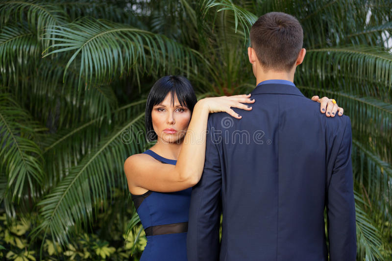 Woman with hands in a businessman royalty free stock images