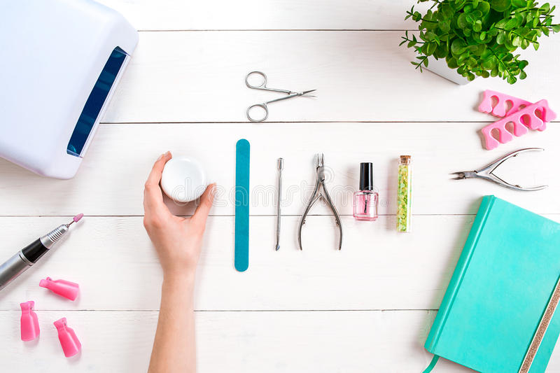 Woman Hands Care. Top View Of Beautiful Smooth Woman`s Hands With Professional Nail Care Tools For Manicure On White. Background. Close up. Top view. Copy space royalty free stock images