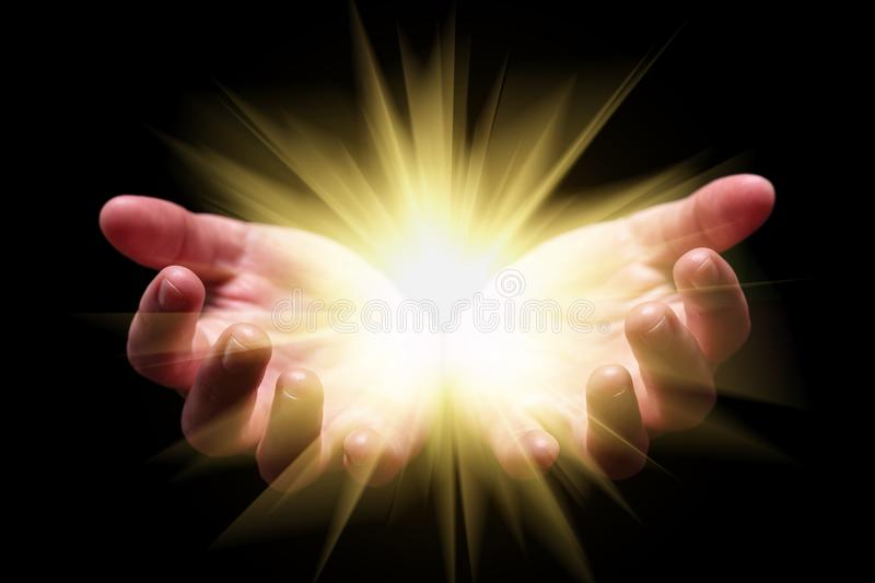 Woman hands cupped holding, showing, or emanating bright, glowing, radiant, shining light. stock image