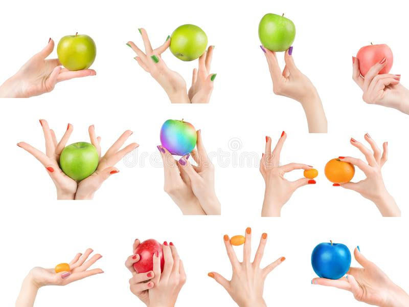 Woman hands with different nail polish and fruits set isolated w. Woman hands with colored nail polish holding different fruits set. Colored apples, tangerines stock images
