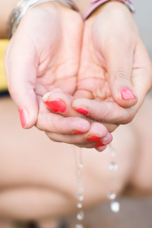 Woman hands with flowing water stock photos