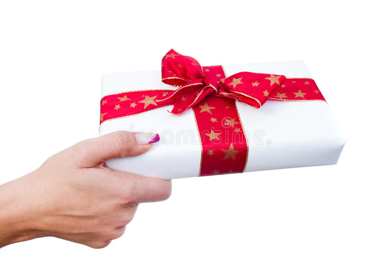 Woman hands giving a gift stock image