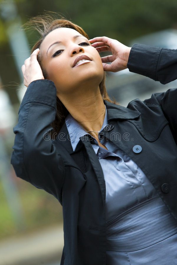 Woman with hands in hair stock image