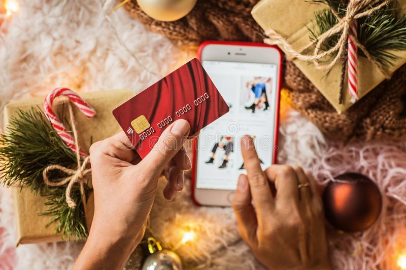 Woman hands holding credit card for online shopping or ordering. Business, Internet shopping and Payment concept. Top view, stock images