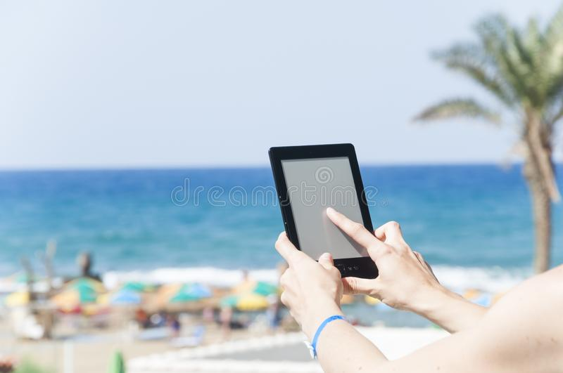 Woman hands holding ebook reader stock photo