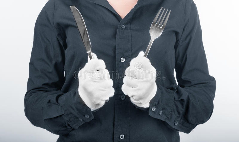 Woman hands holding a fork and a knife royalty free stock photography