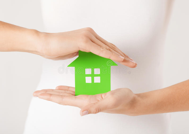 Woman hands holding green house