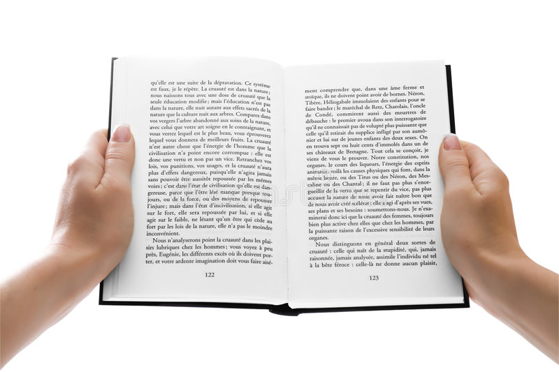 Woman hands holding an open book over white royalty free stock images