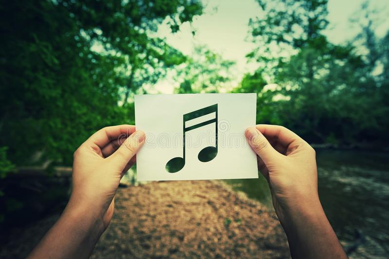 Holding music note stock photo