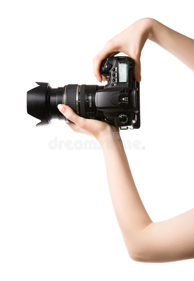 Woman hands holding professional photo camera stock photo