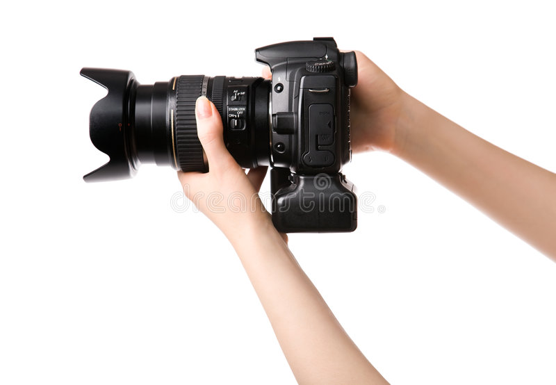 Woman hands holding professional photo camera stock photography