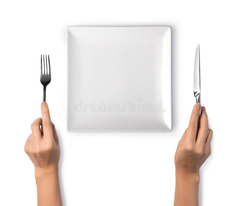 Woman hands holding a silver fork and knife stock photos