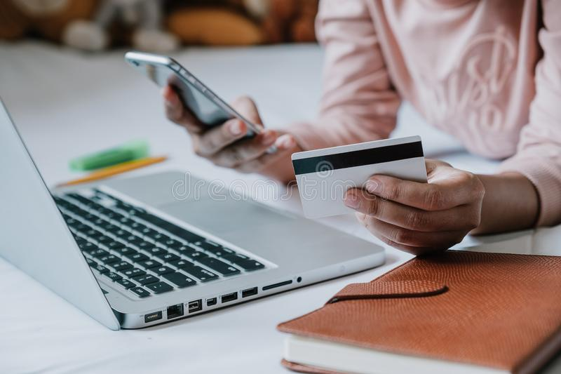 Woman hands holding smart phone and using credit card for online. Shopping.Online shopping concept.Close up royalty free stock photography