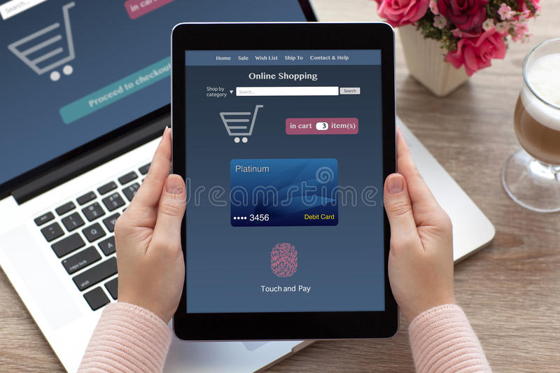 woman hands holding tablet online shopping touch and pay notebook stock photos