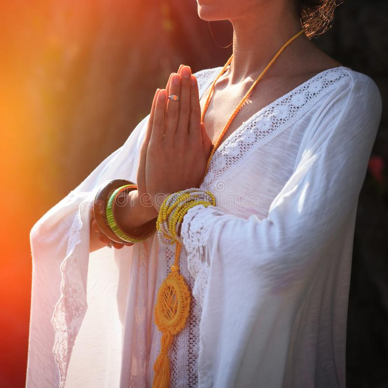 Woman hands in namaste gesture practice yoga outdoor day shot close. Woman hands in mudra namaste gesture practice yoga outdoor day shot close up stock photos