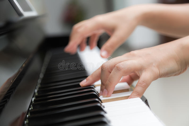Download Woman hands  playing piano stock image. Image of glamour - 58099205