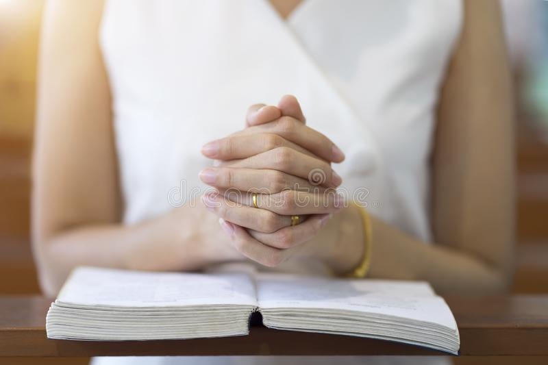 Woman hands praying on a holy bible in church for faith concept, Spirituality and Christian religion royalty free stock photos