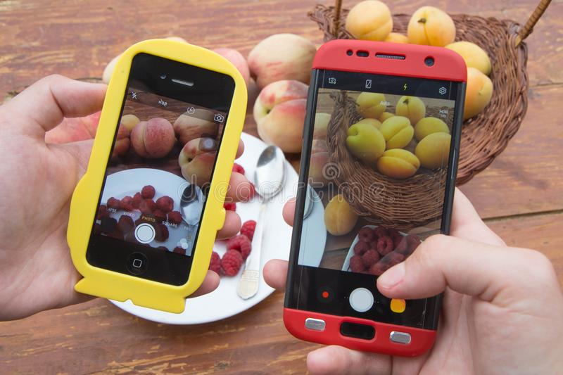Woman hands taking phone photo of Fresh Healthy Organic Fruits. Smartphone photography of lunch, dinner stock photo