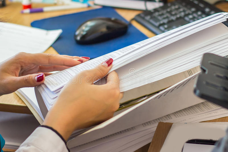 Woman hands turn over papers stock images