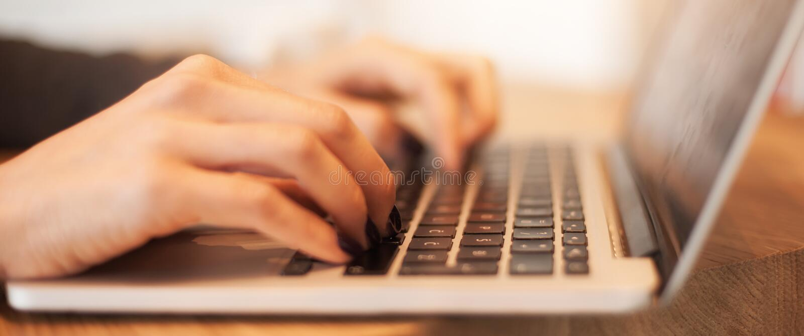 Woman hands typing on laptop keyboard at business meeting. Close up woman hands typing on laptop keyboard at business meeting royalty free stock photo