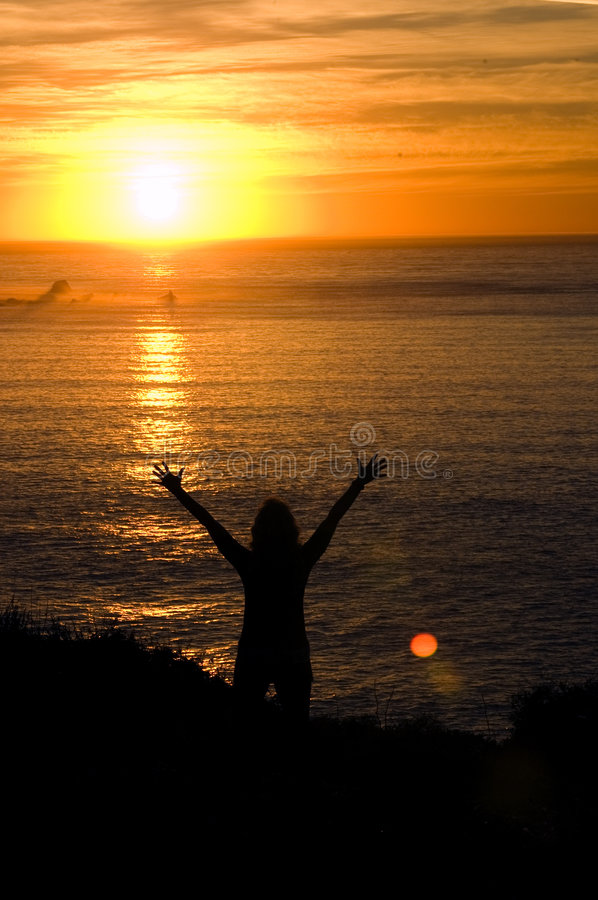 Download Woman With Hands Upheld At Sunset Stock Photography - Image: 7384322