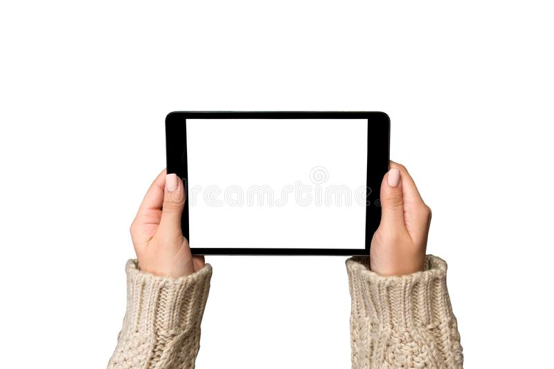 Woman hands using tablet computer isolated on bachground. cristmas shopping time. Happy Christmas mock up background, top view royalty free stock images