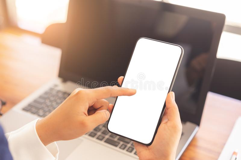 Woman hands using vertical white screen smartphone mockup stock photography
