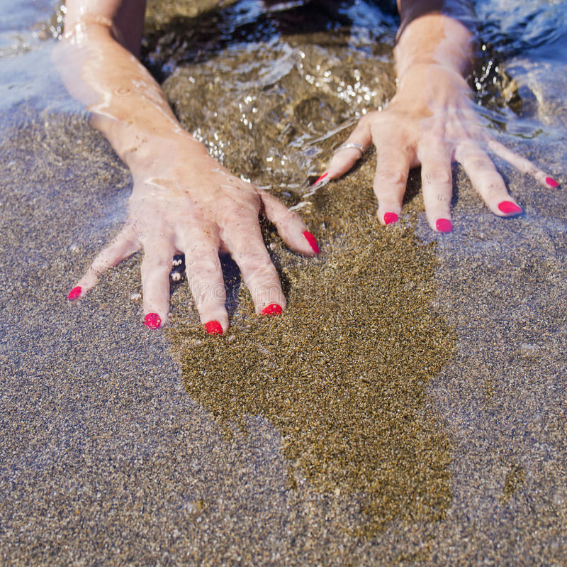 Download Woman Hands On  Water Foreshore,  Black Sand Stock Image - Image: 32805335