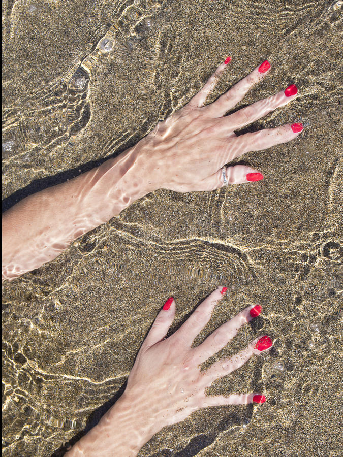 Download Woman Hands On  Water Foreshore,  Black Sand Stock Photo - Image of liquid, glazed: 32805452