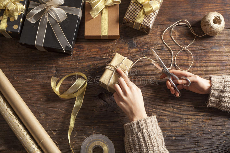 Woman hands wrap gift boxes royalty free stock photo