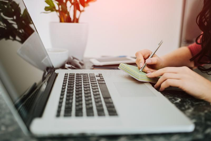 Woman hands writing in front of laptop stock photos