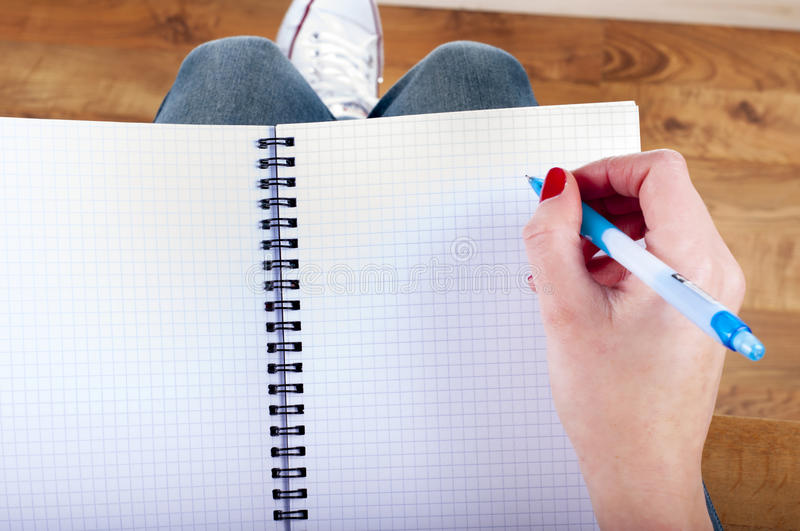 Woman hands writting down on the note book stock photography